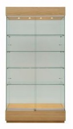 Tall glazed floor display cabinet with wooden base and top and spotlights